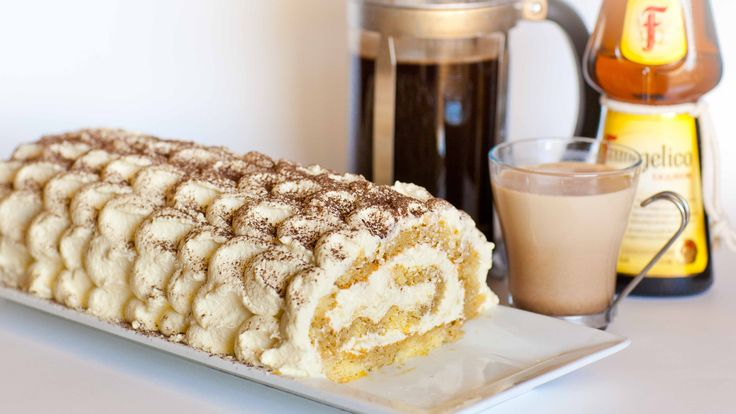 A moist sponge cake roll filled and topped with classic tiramisu filling, made with egg yolks and mascrapone! This simple yet elegant dessert is perfect for a special occasion dinner! Watch my video tutorial for step-by-step instructions, plus decorating tutorial!