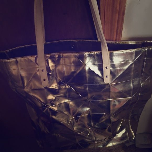 Gold metallic bag! This is a gold metallic bag with white straps! It's really big inside the bag! It could be use as a school bag or anything you like! It does have one pocket inside too! I can take offers as well! Bags Totes