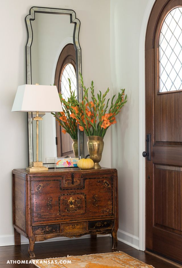 An antique chest mixes with modern accessories at the front door, signaling the design that's in store for guests throughout the home. At Home in Arkansas | November 2015 @lewis1122