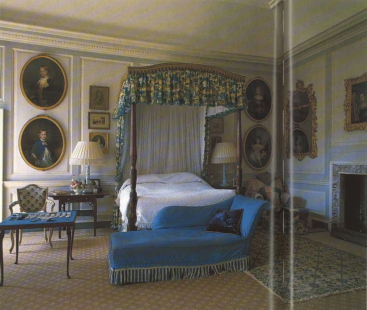 The Duchess bedroom at Badminton. Her personality and presence can be felt in the design: a games table; a favorite chaise longue and a large arm chair with rugs thrown over it for the dog. Colefax and Fowler: The Best in English Interior Decoration by Chester Jones (Bulfinch Press)