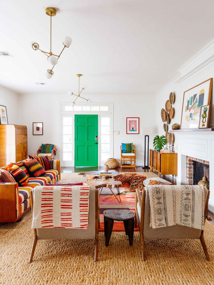 a tan, orange, and red living room with bohemian accents and textiles