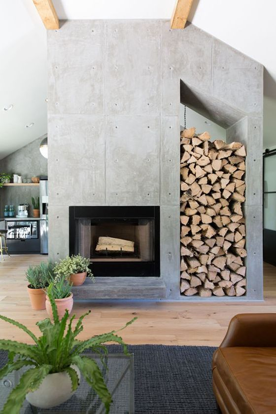 Love this cement fireplace with space for logs