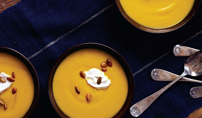 Roasted Squash Soup with Almond Cream & Spiced Pumpkin Seeds  http://kriscarr.com/recipe/roasted-squash-soup-with-almond-cream-spiced-pumpkin-seeds/