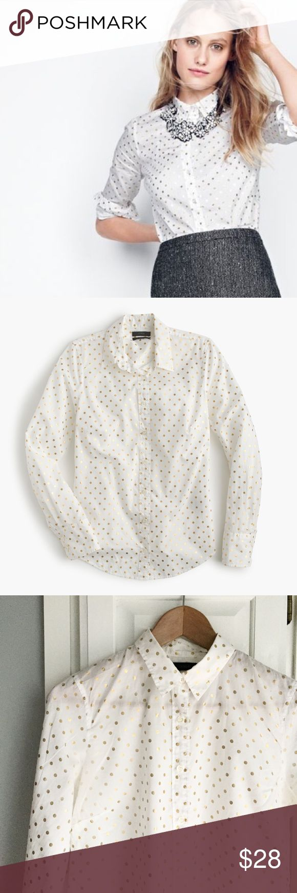 """J. Crew Perfect Shirt in Gold Foil Dot This classic J. Crew top features precisely placed darts for a slimming, waist-defining, tailored fit. This version is crafted in a festive foil dot print that's perfect for the holidays. Cotton with long roll-up sleeves and a button placket. Body length is 26 3/4"""". Machine wash. Slight wear visible on dots that fall under each arm (visible in photos, close-up in final photo). Otherwise in great shape from a pet-free, smoke-free home. J. Crew Tops…"""