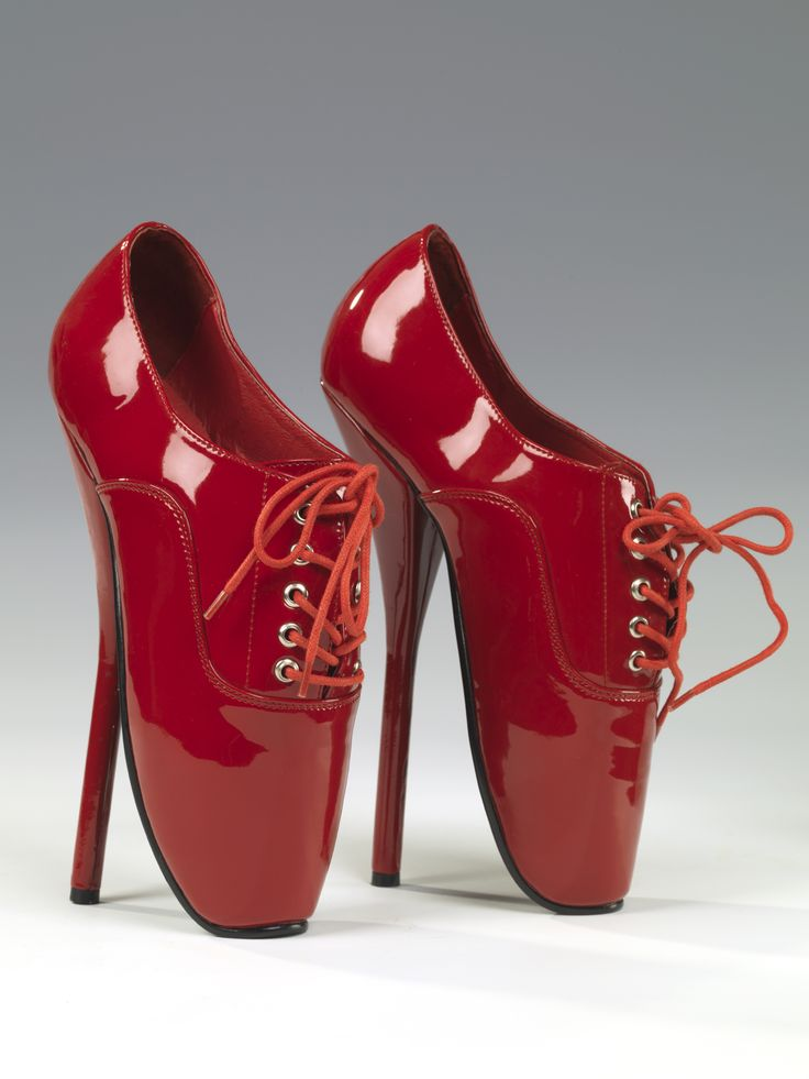Pair of women's red synthetic patent 'ballet' style lace shoes. Vertical foot. Five pairs of eyelets. Label on sock: Devious. Very high heel. Made in China, 2007