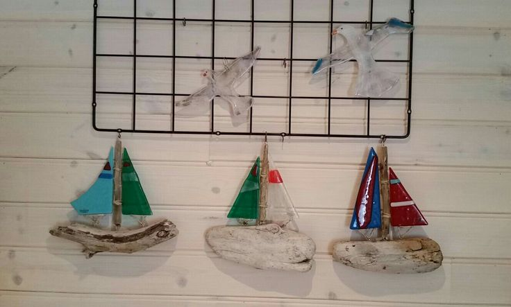 Sailboats made of old wood and glass sails