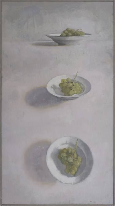 Three plates with white grapes.