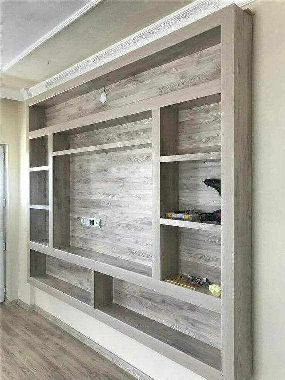 Our Custom Entertainment Center Is Mounted Flush Against A Wall Wall Entertainment Center Floating Shelves Entertainment Center Entertainment Center Wall Unit
