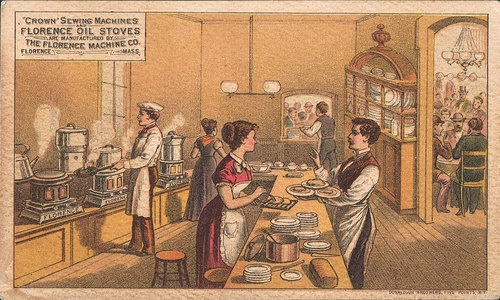 Victorian Kitchen Interior-People Work Using FLORENCE OIL STOVES