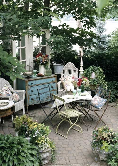 How to cope with shade: cottage chic ~ beautiful backyard garden with small distressed dresser and table setting.