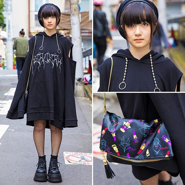16-year-old Shio (@xx94by12xx) on the street in Harajuku wearing dark fashion from the popular Harajuku boutique Never Mind the XU with Demonia boots and a Tokyo Disney Sea purse.