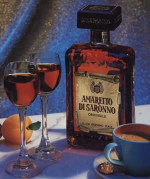 """Amaretto - (Odor profile: Reminiscent of bitter almond (the actual liqueur is made from apricot pits which have an almondy nuance), usual in gourmand perfumes).  Amaretto is a sweet Italian liqueur often compared with sherry. It's composed of almonds, apricots (or cherries) and spices. The name Amaretto originates from Amaro, meaning """"bitter"""" in Italian. It is often added to various kinds of sweets, chocolates or cakes."""