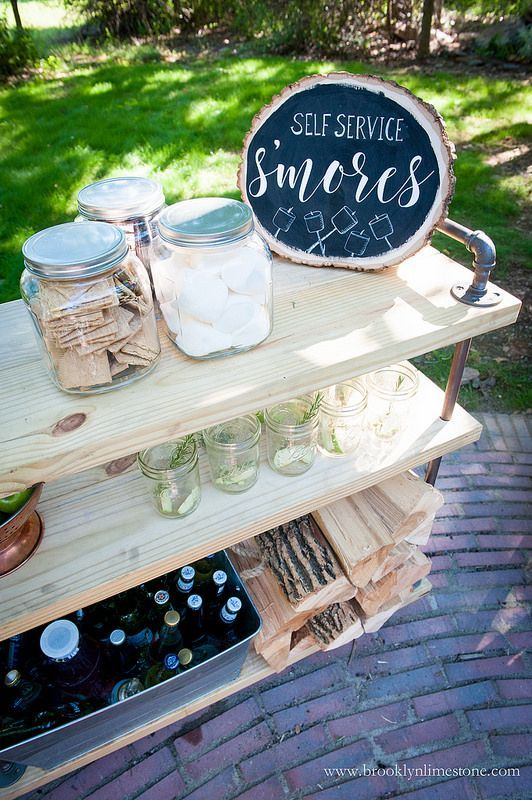 Lumber and pipes were used to make this s'mores fixings cart. This mobile cart serves multiple purposes as BBQ cart, firewood caddy or an outdoor bar cart as needed.