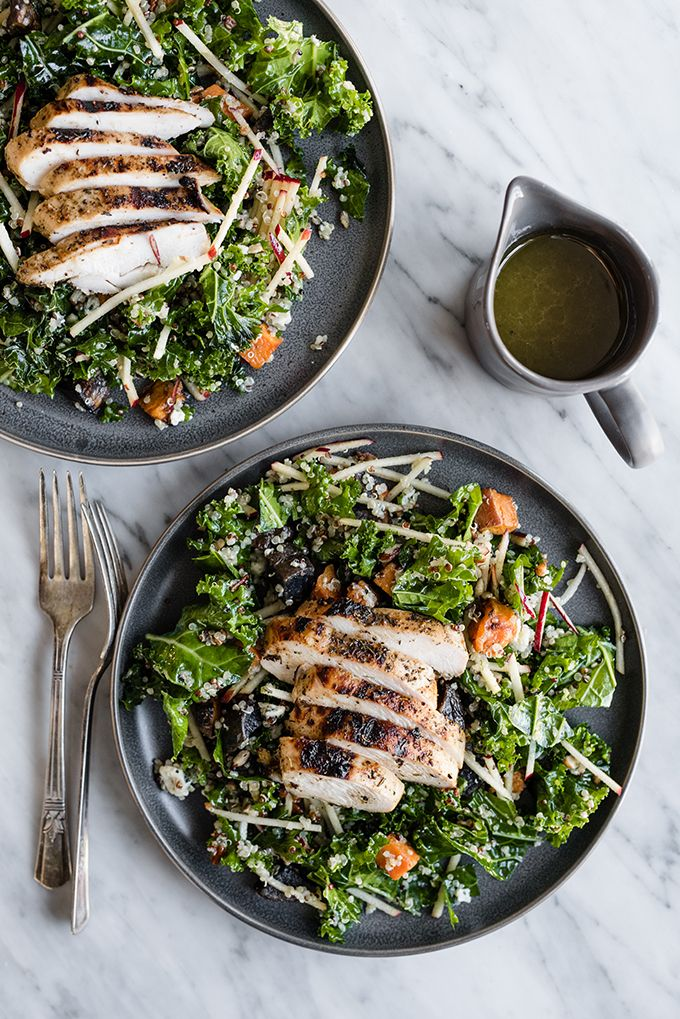 This kale chicken salad is the quintessential recipe for a fall harvest salad. It's made with super crispy apples, kale, grilled apple cider chicken, and warm potatoes, then dressed with a sweet and tart maple cider vinaigrette.
