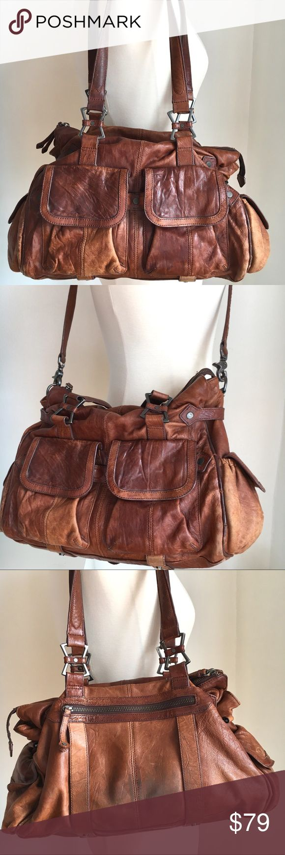 Junior Drake Leather Shoulder Cross body Satchel Junior Drake Leather Shoulder and  Cross body Hobo Style Satchel Tote in Cognac Color. Butter soft Italian leather imo gets better with age. has detachable Cross Body strap.. Many pocket compartments.   Gently preowned. Has some normal wear marks and freying on the straps shown.  Pls review all photos and use the zoom feature for condition. Junior Drake Bags