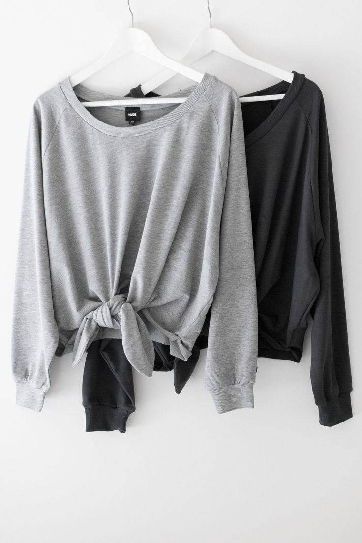 """Super comfy oversized pull-over sweatshirt with front knot detailing. Wide neckline and a slouchy fit. Made with french terry knit material. Size small measures approx. 21"""" in length. - 35% Cotton 65%"""