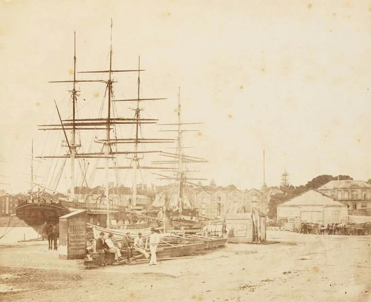 The La Hogue moored at Circular Quay,Sydney in 1875. La Hogue was a wooden full-rigged ship built by James Laing,Sunderland and launched in 1855 for Duncan Dunbar.She was used in the passenger and cargo trade to Australia and New Zealand.Her figurehead was a lion rampant supporting a shield with the St Andrew's Cross.