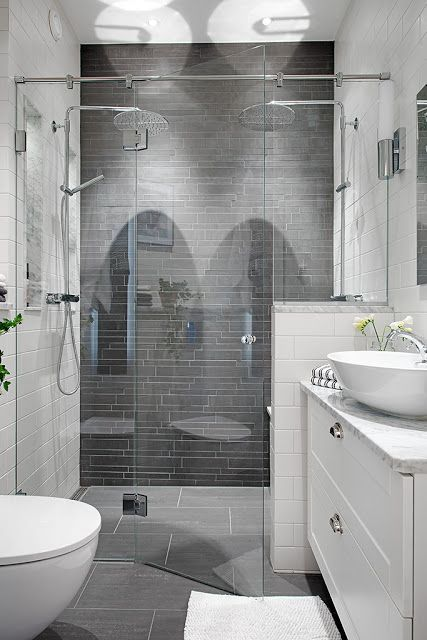 Double shower heads, grey tile, white everything else. Love this.