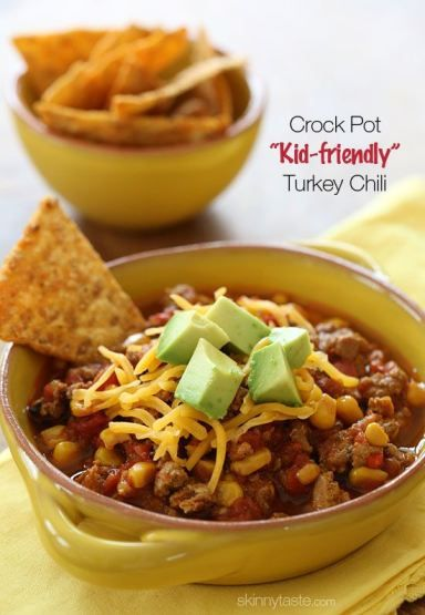 Crock Pot Kid-Friendly Turkey Chili - made mild for the kiddos, with lean turkey, corn, bell peppers and tomatoes. My toddler loves this!