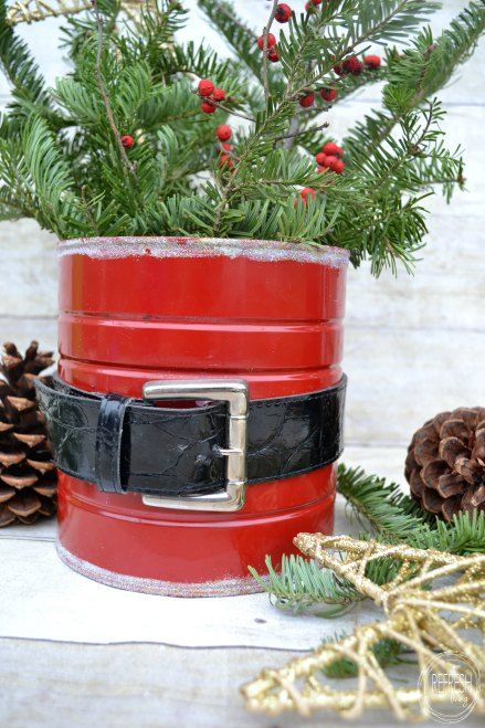 An old coffee can and belt used to make a Santa can to hold greenery, poinsettia plants, or flowers.