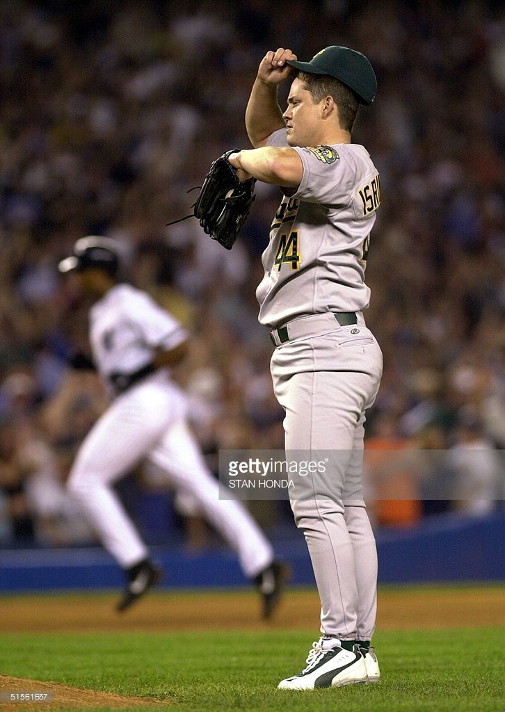 AUGUST 8,   2000 - In the bottom of the ninth, A's closer Jason Isringhausen throws just two pitches, and the Yankees go from losing 3-2 to winning 4-3. Bernie Williams and David Justice both hit home runs on the first pitch they see from the Oakland reliever. [photo: Williams circles the bases on Isringhausen]