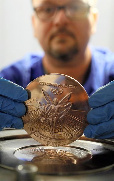 #RIO2016 A worker displays a bronze medal for the Olympic games as the production in full swing on July 18 2016 in Rio de Janeiro Brazil