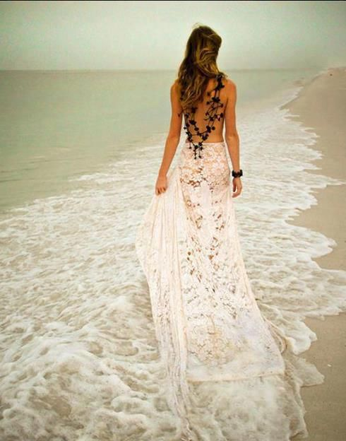 Backless lace wedding dress? Whatever it is, it's great wedding photography inspiration!