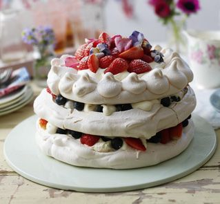 This pavlova makes a stunning centrepiece for any party. Fill with your favourite fruit and decorate with crystallised flowers.
