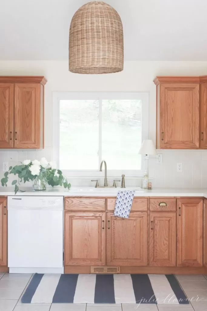 Updating A Kitchen With Oak Cabinets Without Painting Them In 2020 Oak Kitchen Oak Cabinets Kitchen Remodel Small