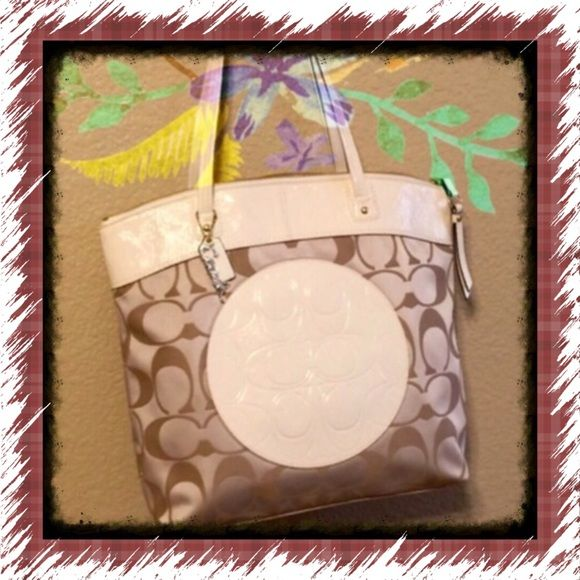 HP SALE Coach  Tote NEW This sale will return to 135.00 Sunday evening.  Lovely two tone beige and bone colored tote.....New never used very classy...I have sprayed the material with scotch guard so to not stain or dirty... vinyl shiny material bone colored along with light beige canvas.... Coach Bags Totes