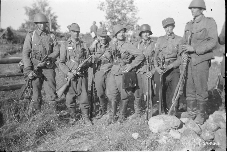 """Lieutenant Kokko (centre), who, with his men, attacked the rear of the enemy on their own initative, and brought the battle to victory."" - Village of Yläjärvi - 18 July 1941."