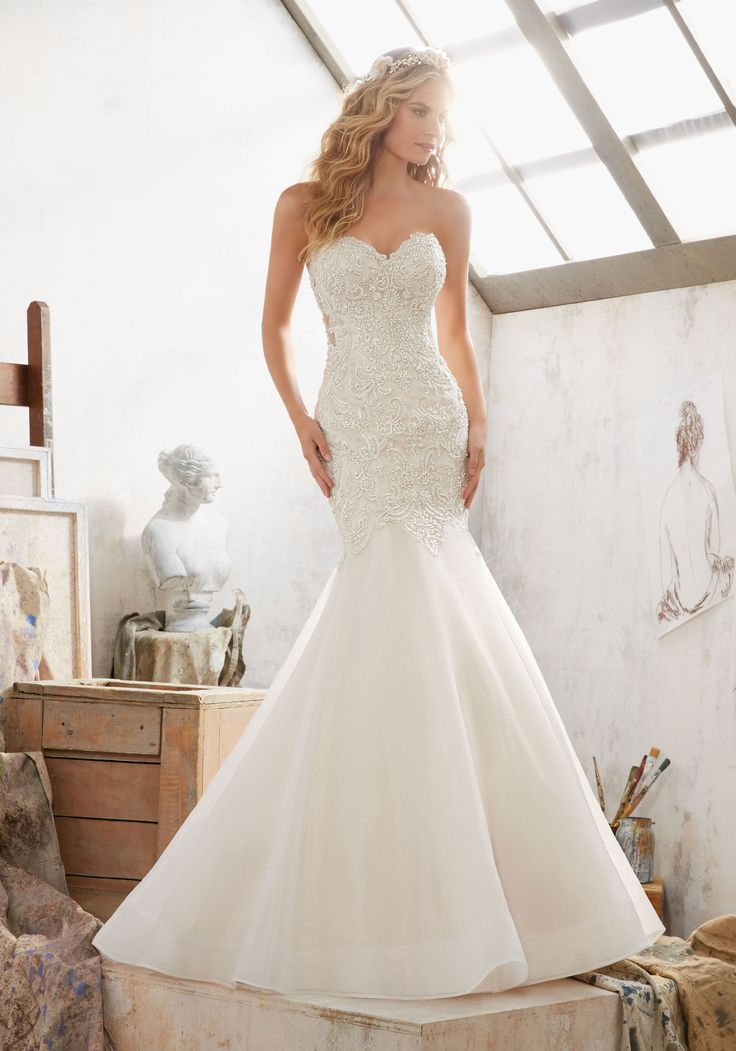 Morilee by Madeline Gardner 'Margot' 8120 | Crystal Beaded Embroidery Over Chantilly Lace. Romantic Sweetheart Neckline and Organza Skirt. Covered Button Details Accent the Corset Style Illusion Back.
