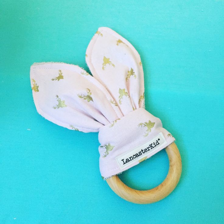 A personal favorite from my Etsy shop https://www.etsy.com/listing/386335134/babbity-wooden-teething-ring-bunny