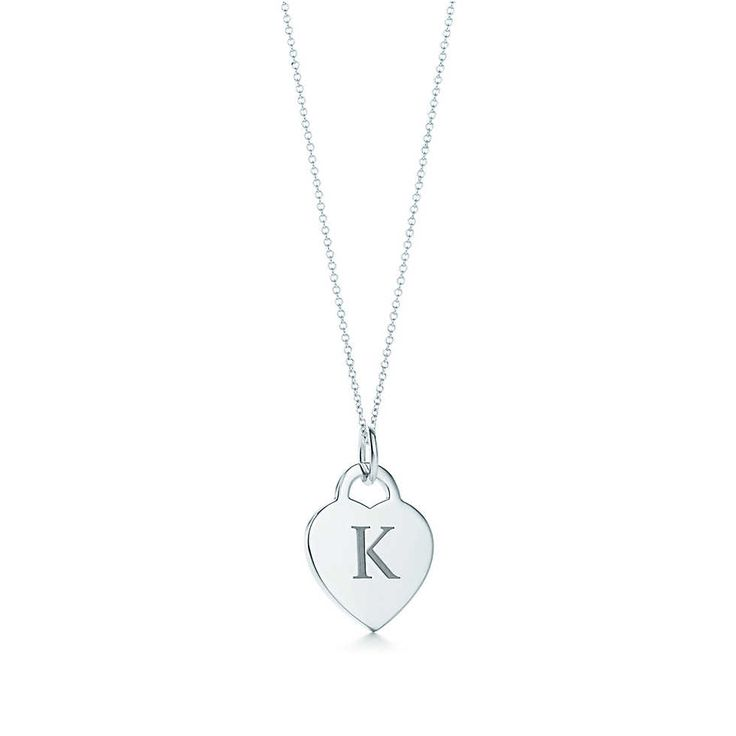 Alphabet heart tag letter charm in silver on a chain. Letters A-Z available.