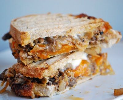 Cheese Steak Panini - indulgent, using thinly sliced rib eye steaks. If you don't have a Panini Press, which most people don't, I know I don't, just use your usual method for making grilled cheese - I use a cast iron skillet. You can always try it on a George Foreman Grill or similar, if you have one of these. Either way, this is a sumptuous sandwich. Get the napkins ready !