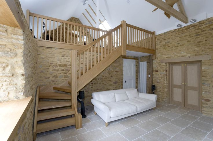 Oak open riser stair with thick treads and wide newels, complete with balustrade all in oil finished oak.