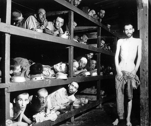 This April 16, 1945 photo shows inmates of the Nazi German KZ Buchenwald inside their barrack, a few days after U.S troops of the 80th Division liberated this concentration camp near Weimar. The young man seventh from left in the middle row bunk is Elie Wiesel, who would later become an author and Nobel Peace Prize laureate. (AP Photo)