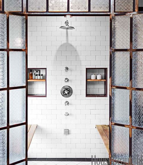 """Shower fixtures, from the Astaire collection by Newport Brass, are arranged in a line. """"It looks neat and clean that way,"""" says designer Deirdre Doherty.   - HouseBeautiful.com"""