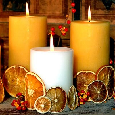 Warm up your holiday table with a scentsational centerpiece — dress pillar candles with dried oranges, lemons, and limes. Using a glue gun, connect the citrus slices to each other, forming a band around the base of each candle.  What you'll need: pillar candles ($20 for a 3-pack, amazon.com), dried lemon slices ($16, amazon.com)