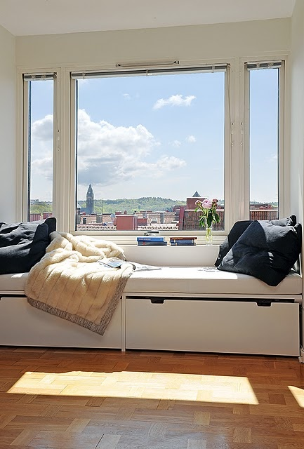 Turn your window into a seating area to create innovative storage solutions