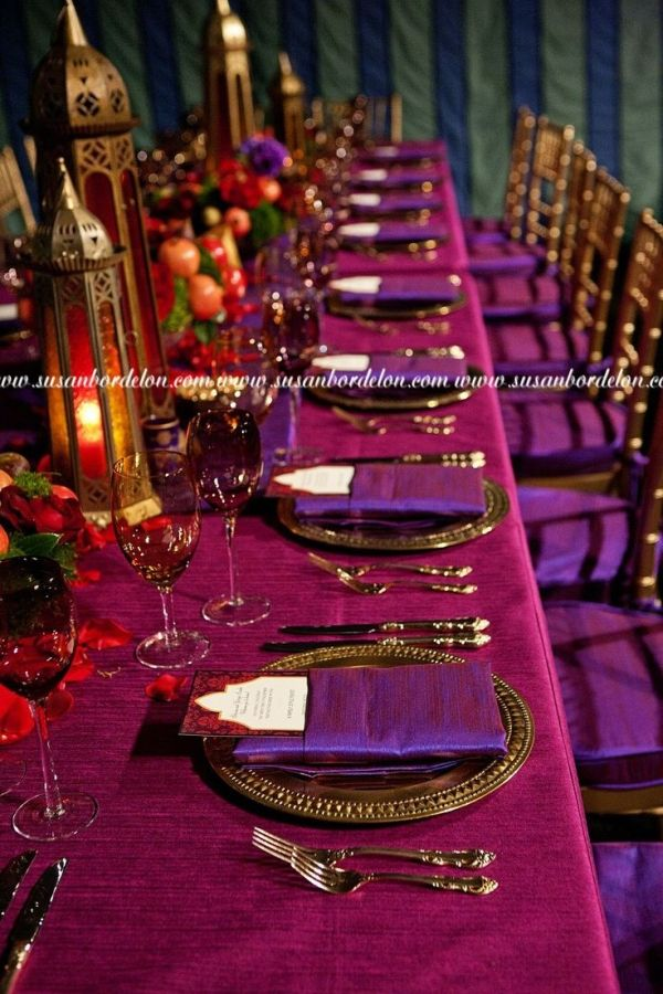 Rich purple toned Moroccan themed table setting.