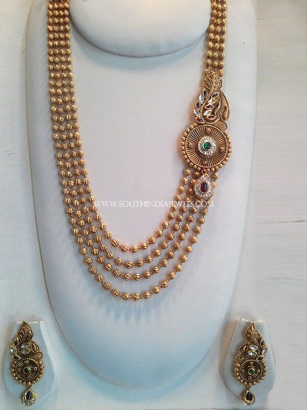 22K Designer gold ball haram set with matching earrings. For inquiries please contact the seller below. Seller Name : New Sri Vasavi & Co Jewellers Website : http://www.newsrivasavijewellers.com/home.aspx Contact : 0422 239 6706 Ext 4360349 Related PostsMultilayer Gold Ball Haram With Side LocketGold Plated Long Lakshmi Necklace with JhumkaGold Ball Haram With EarringsGold Long Lakshmi …