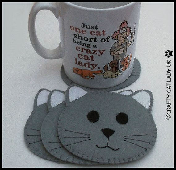 This Cat Face Coaster has been made from felt (3 layers thick) and apart from the whiskers which are machined it is all hand sewn. It measures
