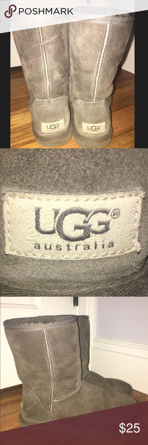Grey ugg boots + socks Short mid-calf grey uggs. Obvious signs of wear!!! UGG Shoes Winter & Rain Boots