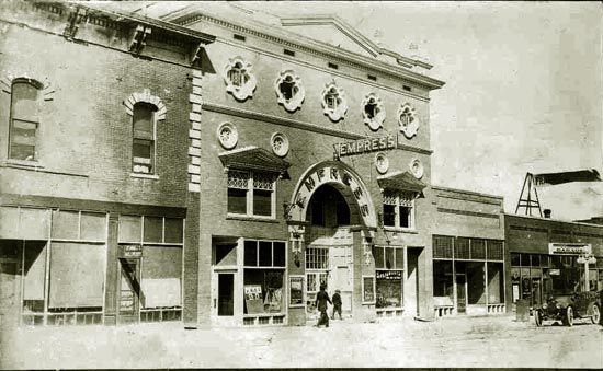 Empress Theater (now the empty Fox Hole :( and Frazier's Garage (to the right) now home to the Cowboy Saloon.