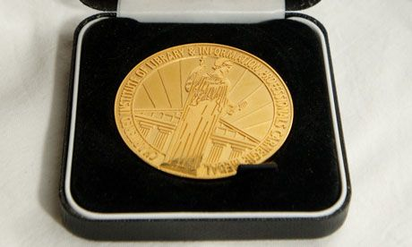 The much-coveted Carnegie medal for children's fiction. Photograph: Linda Nylind for the Guardian