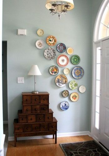 Wall: BM 2123-5- Ocean Air (a favorite of mine); trim: BM Super White PM-1 An assemblage of vintage plates makes for another art form, one that offers welcome whimsy to this short and rather nondescript entry. Image: arcadianhome.com
