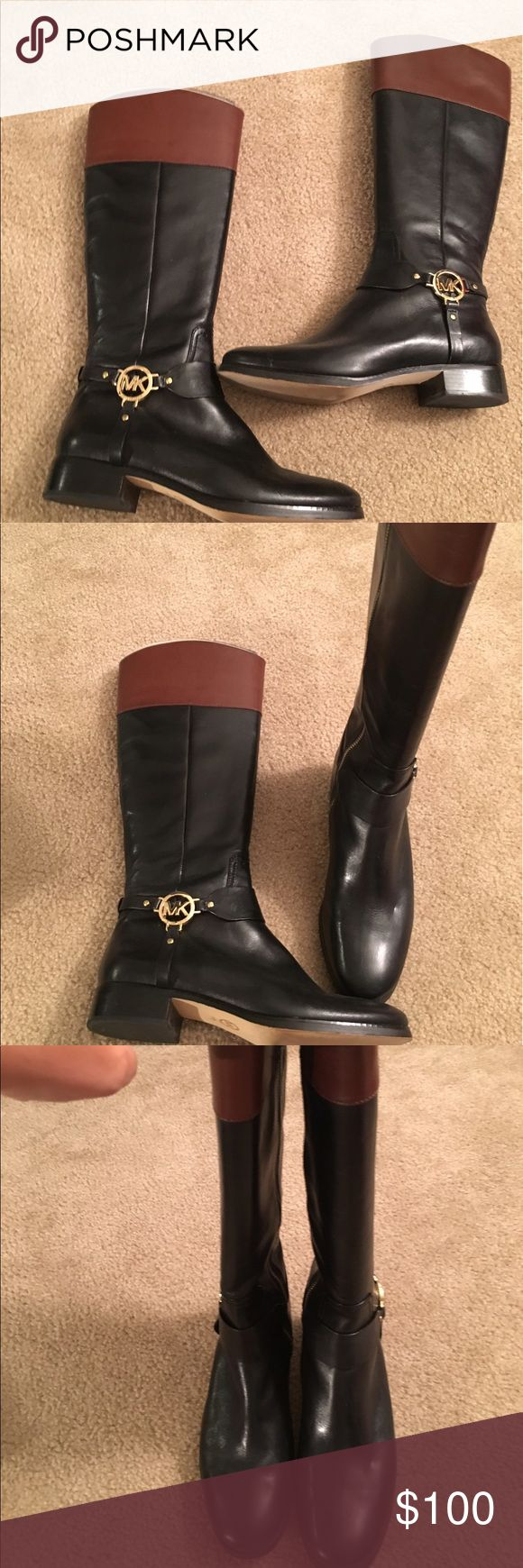Michael Kor black and brown leather riding boots Hardly worn black and brown leather with gold logo Michael Kors Shoes Combat & Moto Boots