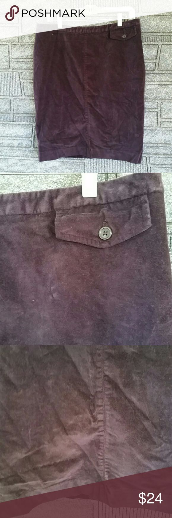 Gap crushed velvet purple pencil skirt 12 NWOT Gap crushed velvet purple pencil skirt 12 NWOT Skirt features a front fake pocket, rear slit and rear zipper and button closure. Darts in the back add shaping. Color is dark purple. Skirt is fully lined. Shell is 99% cotton, 1% spandex, lining is 100% polyester. Measures 22 inches long, 16.5 inches waist. GAP Skirts Pencil