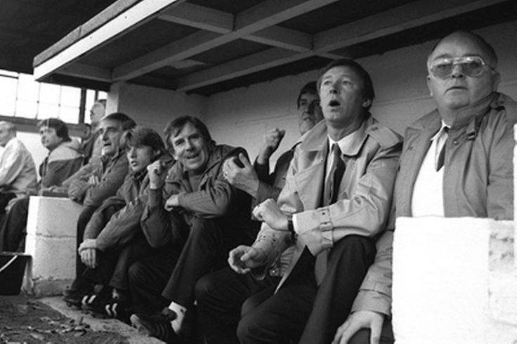 Manchester United manager Alex Ferguson (second right) watches his new team for the first time as they crash to a 2-0 defeat.